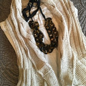 Sleeveless cable sweater